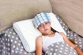 Girl with heatstroke lying in bed.