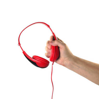 Objects Hands action - Hand holds Headphones. Isolated