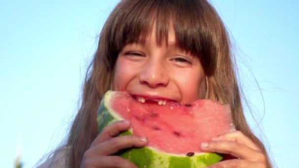 little girl eating watermelon slow motion