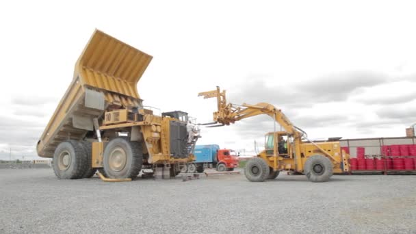 heavy dump truck and loader in open pit