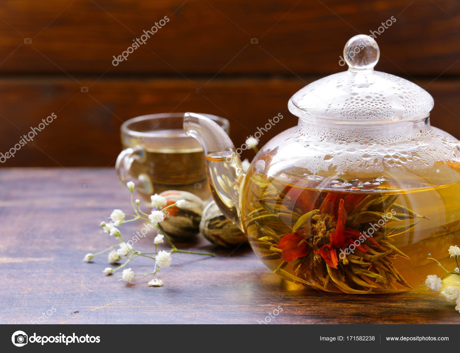 Green Tea Flower Celestial Lily In A Glass Teapot Stock Photo