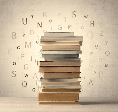 Books with flying letters on vintage background