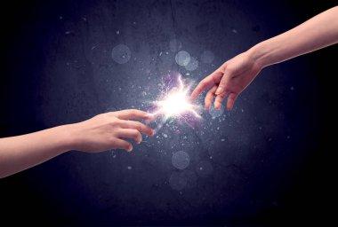 Hands reaching to light a spark