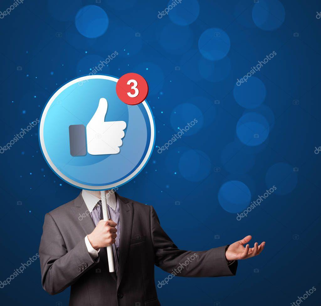 Businessman holding facebook sign