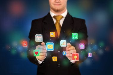 Businessman holding application icons