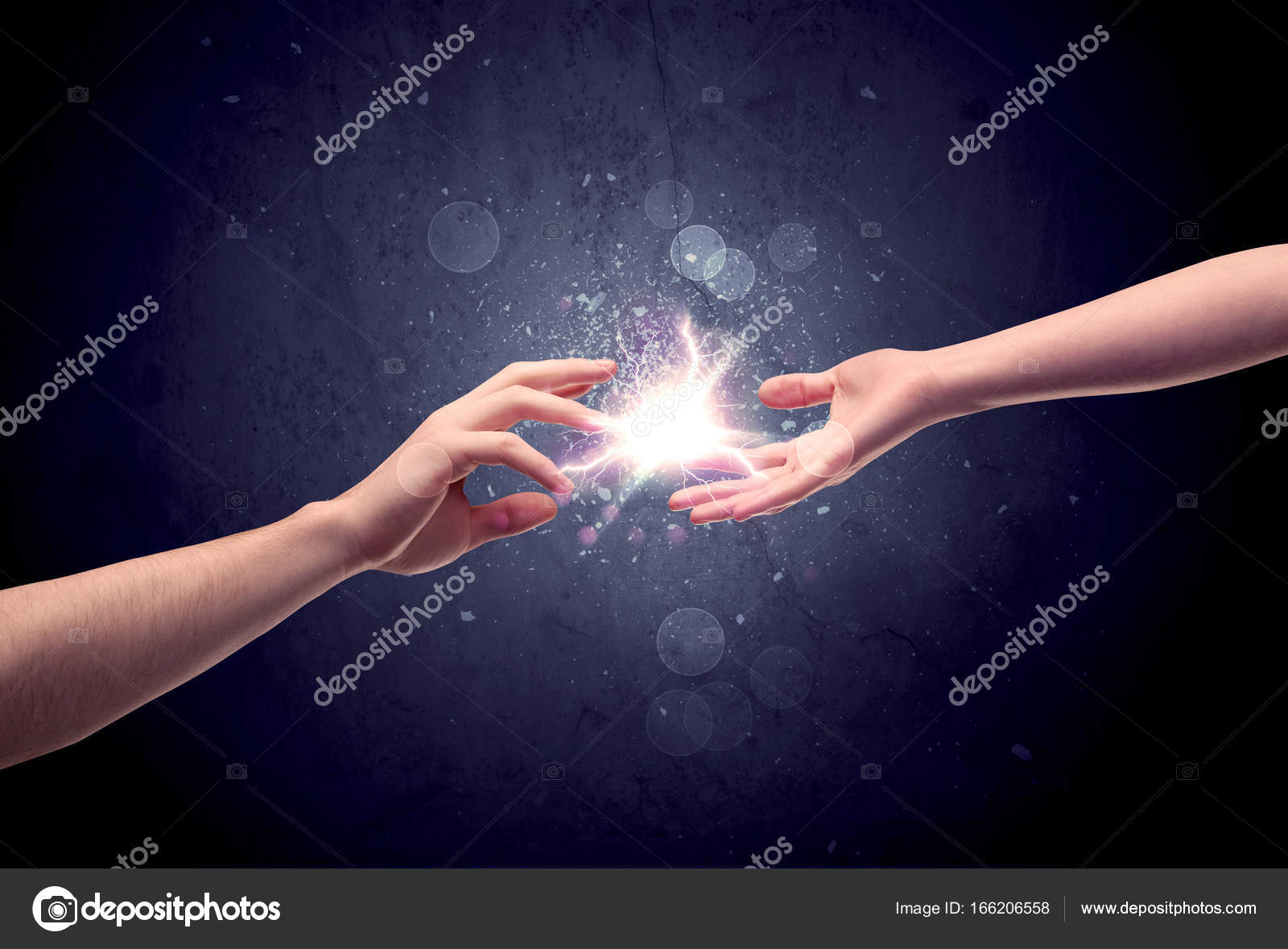 Hands reaching to light a spark u2014 Stock Photo & Hands reaching to light a spark u2014 Stock Photo © ra2studio #166206558