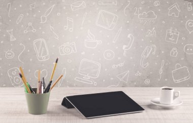 Design office desk with drawings background