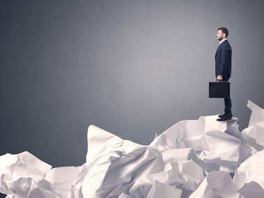 Businessman standing on crumpled paper