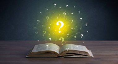 Yellow question marks hovering over open book stock vector