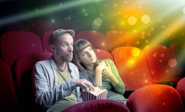 Fanciful couple watching miraculous part of a movie stock vector