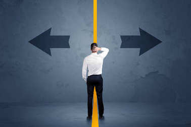 Business person choosing between two options separated by a yellow border