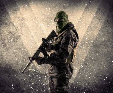 Portrait of a dangerous masked armed soldier with grungy light background stock vector