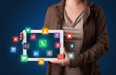 Woman holding tablet with multimedia graphics