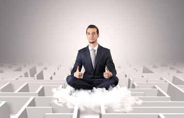 Young businessman meditate in yoga position on a cloud with infinity maze concept stock vector