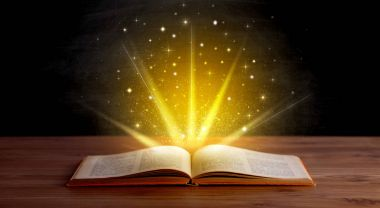 Yellow lights and sparkles coming from an open book stock vector