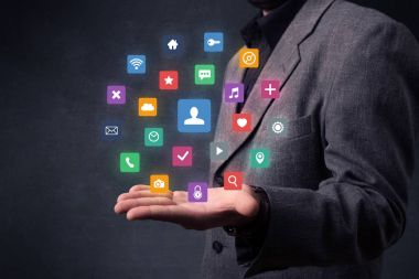 Businessman holding colorful applications