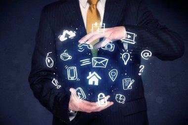 Businessman holding blue applications