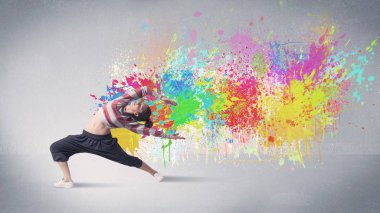 A funky contemporary hip hop dancer dancing in front of grey background with colorful bright paint splatter concept stock vector