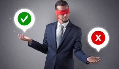 Blindfolded businessman with checked and x mark above his hand stock vector