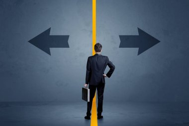Business person choosing between two options separated by a yellow border arrow