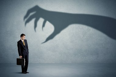 Business person afraid of a big monster claw shadow concept on background stock vector
