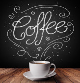 Steaming cup of coffee with white doodles