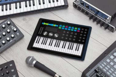 Piano app on tablet and musical instrument concept