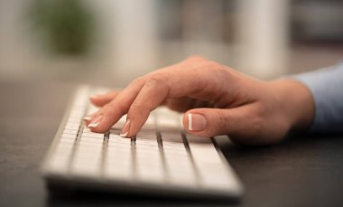 Business woman hand typing on keyboard