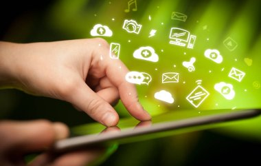 holding tablet with social media concept