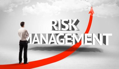 Rear view of a businessman standing in front of RISK MANAGEMENT inscription, successful business concept stock vector