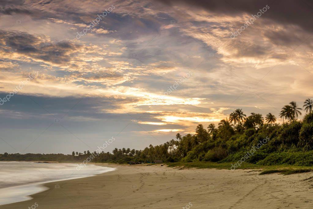 Фотообои Sandy tropical beach at sunset