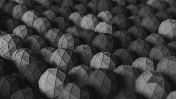 Absztrakt fehér és zöld alacsony poli labdák simán mozognak fel és le. 3D hurok animáció.