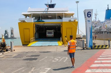 Unloading vehicles from ferry boat in Piombino seaport, Italy