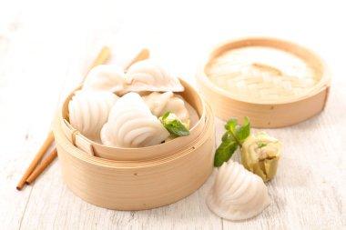 dumplings in wooden bowl