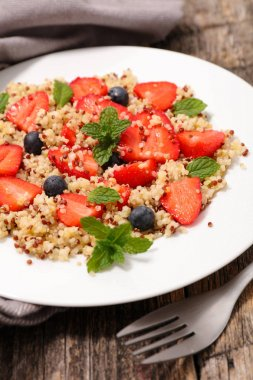 strawberries and quinoa on plate