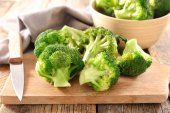 fresh broccoli on table, close up view