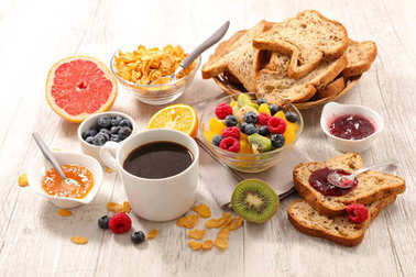 breakfast with fruit,coffee cup and bread