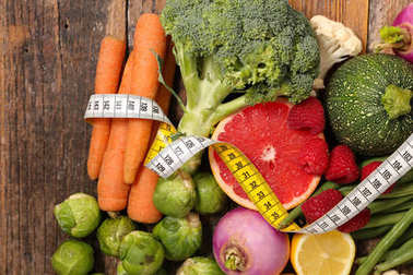 pile of vegetables with measuring tape, healthy food concept