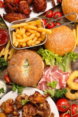 Top view of assorted american food served on wooden table.