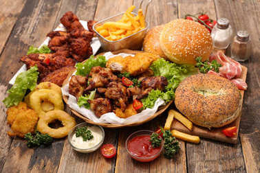 Assorted american food served on wooden table.