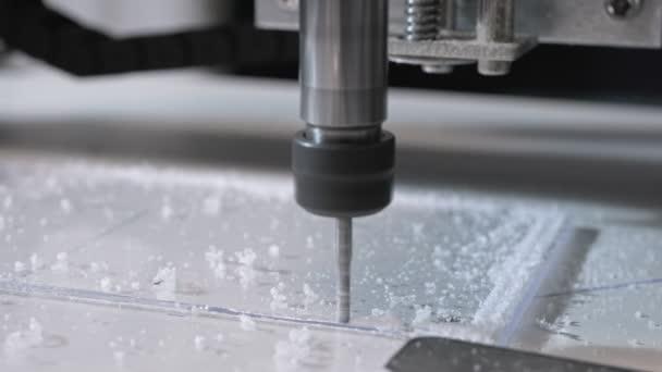CNC milling machine proceccing plastic detail..