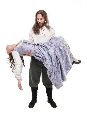 Handsome man in medieval costume holding beautiful woman on his