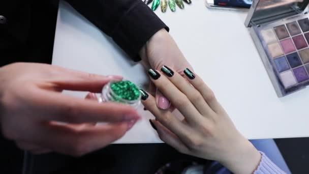 Manicurist making fashion nailart.