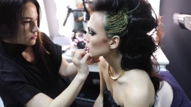 Manicurist making fashion nailart. Woman Applying Nail Polish.