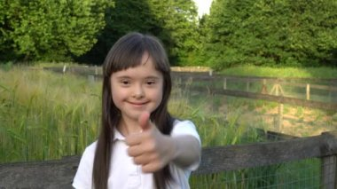 Down syndrome girl have fun outside
