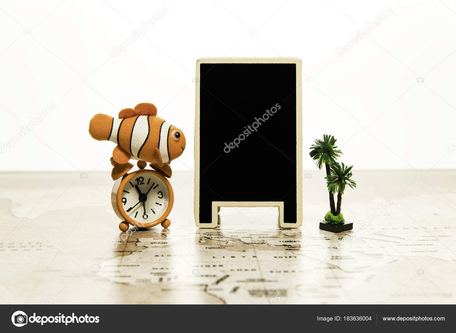 Blank black board alarm clock small palm tree world map stock blank black board alarm clock small palm tree world map stock photo gumiabroncs Image collections