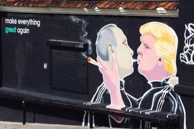 Mural artwork of Putin and Trump smoking joint