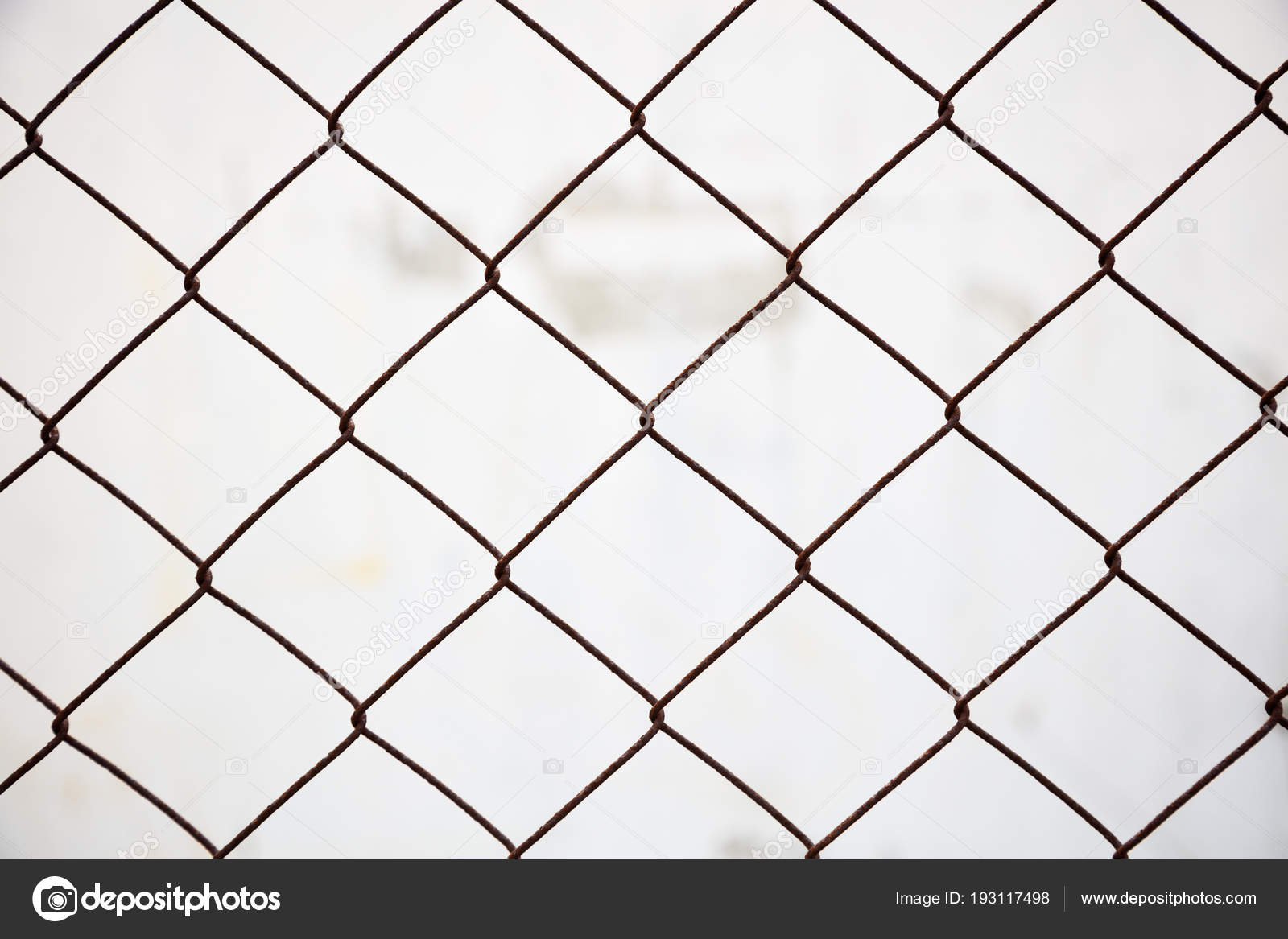 Wire mesh fence made of steel with blurred background. Close up view ...