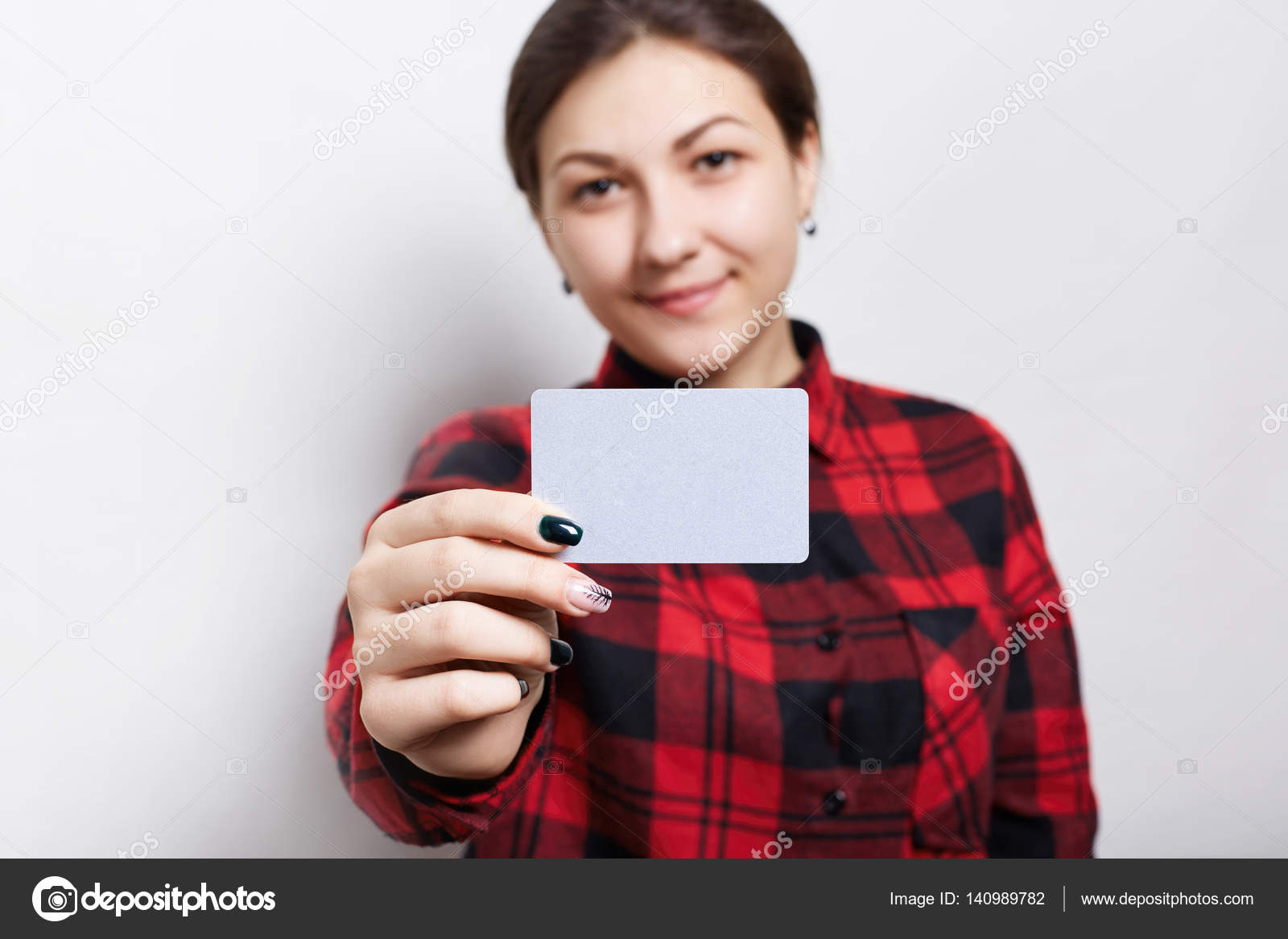 Selective focus. Portrait of female businesswoman in checked red ...