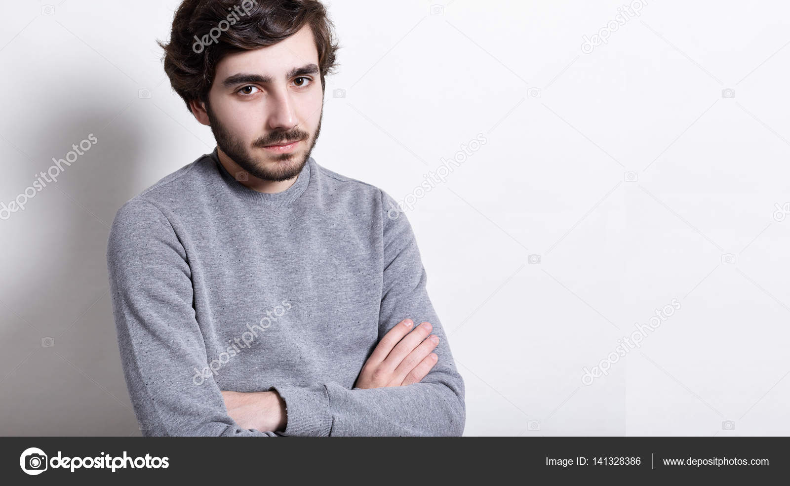 Headshot of fashionable young hipster with trendy hairstyle